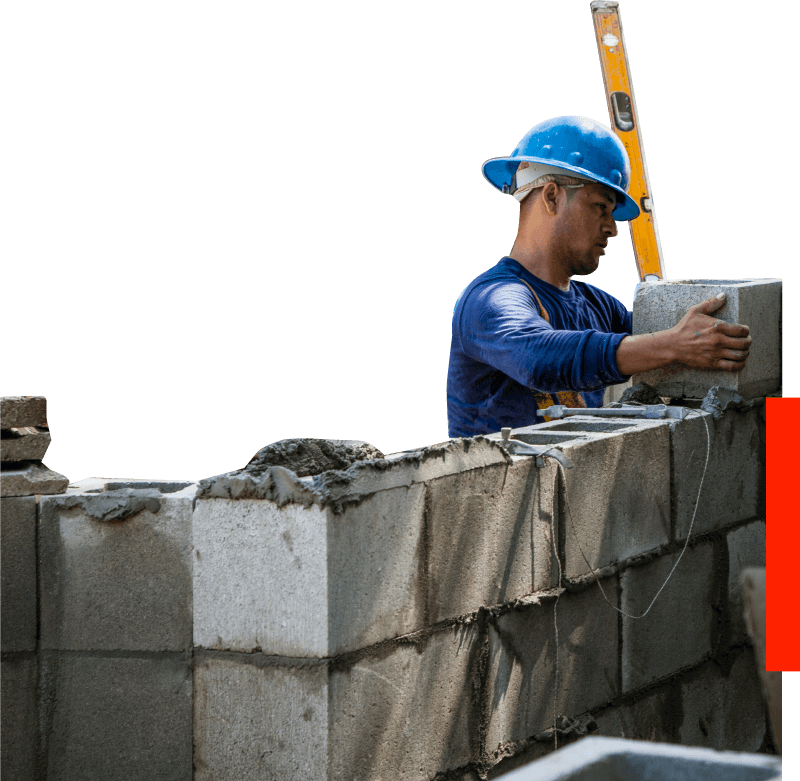 Construction worker placing bricks - Construction services in GTA Toronto - Niche Contracting - Overhead Protection - Disinfection - Concrete repair - Masonry - Carpentry